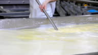 Making cheese in dairy factory video