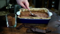Making chocolate dessert. Preparing for baking cake. Man hand spread chocolate video
