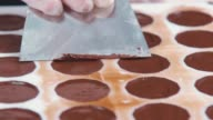 Making chocolates. Chocolatier in the process. The body of chocolates video