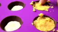 Making chocolates in magenta silicone form. FullHD close up shot, part of the set video