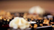 making creamy star of chocolate Dessert with honey crumbs in a restaurant video