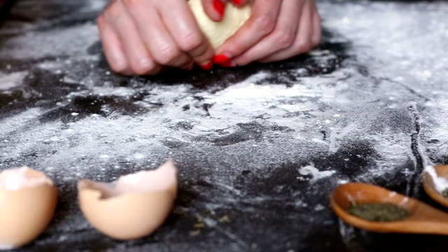 Making dough by female hands at bakery video