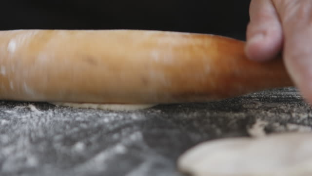 Making meat dumpling with wooden rolling pin. video