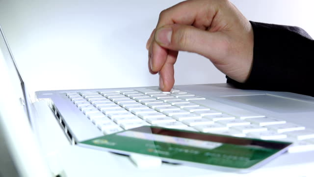 making on line shopping with credit or debit card video