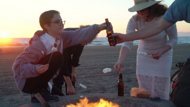 Making S'mores on a beach fire video
