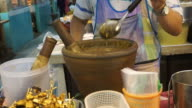 Making Thai chilli fresh paste in a mortar with pestle video