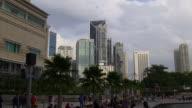 malaysia kuala lumpur sunset light klcc mall fountain crowded tourist panorama video