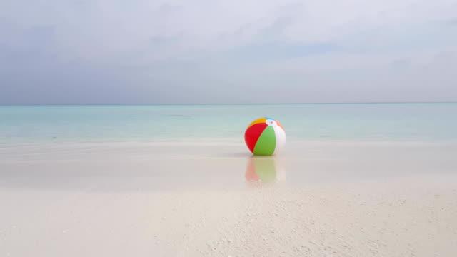 Maldives beautiful beach background white sandy tropical paradise island with blue sky sea water ocean 4k ball video