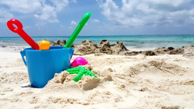 Maldives beautiful beach background white sandy tropical paradise island with blue sky sea water ocean 4k bucket spade video