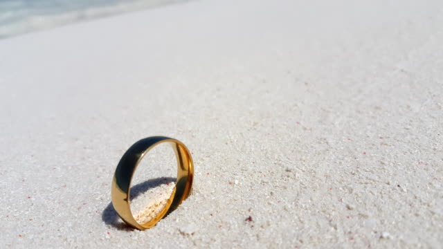 Maldives beautiful beach background white sandy tropical paradise island with blue sky sea water ocean 4k gold wedding ring video