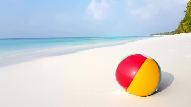 Maldives beautiful beach background white sandy tropical paradise island with blue sky sea water ocean 4k beachball video