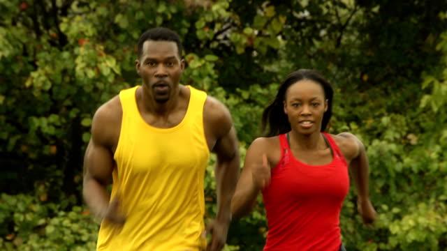 Male and Female Athletes Run Toward Camera video