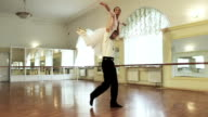 Male and female dancers practicing ballet lifts in the studio video