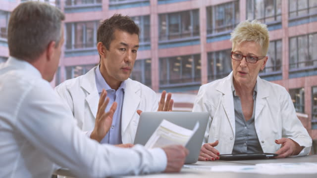 LD Male and female doctor having a meeting with the project manager video