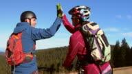 SLO MO Male and female mountain biker doing high five video