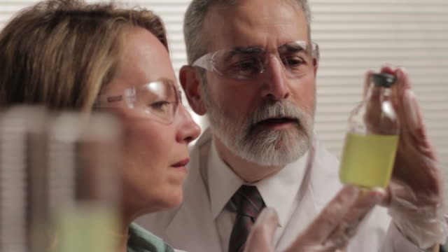 Male and female researchers in the lab video