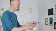 Male artist analyzing a draw. video