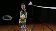 SLO MO Male badminton player hitting a shuttlecock video