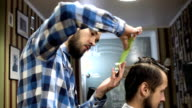 Male barber and client are talking about haircut, smiling and laught video