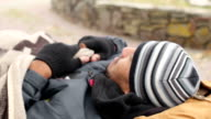 Male beggar sleeping on bench and waking up, homelessness, living in poverty video