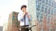 Male Business executive on Bicycle outside office video