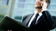 Male Caucasian Financial Advisor Smart Phone City Outdoors video