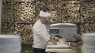 Male chef preparing a pizza and kneading the dough video