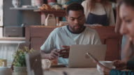 Male Customer In Coffee Shop Using Laptop Shot On R3D video