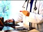 Male doctor analyzing specimen video
