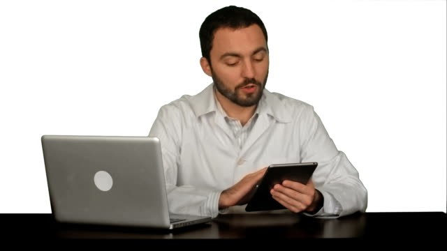 Male doctor holding digital tablet and talking with his patient on white background video
