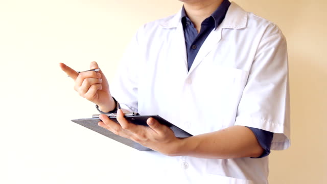 male doctor holding patient note on clipboard, writing and discussing about patients' symptoms video