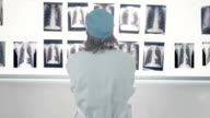 Male Doctor Looking At X-Ray video