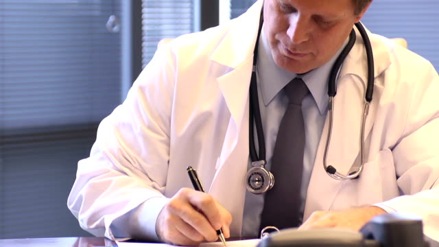 Male Doctor Works in Office video