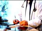 Male doctor writing a prescription video