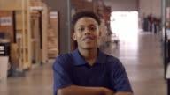 Male Factory Worker Walks Towards Camera In Slow Motion video