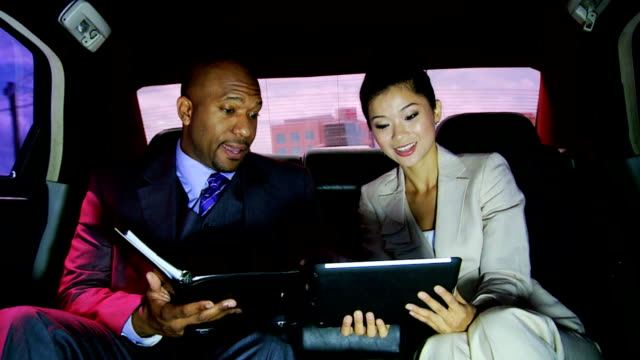 Male Female Business People Being Driven Luxury Limousine video