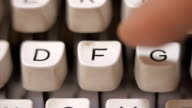Male finger typing letter F on old, retro typewriter. video