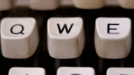 Male finger typing letter W on old, retro typewriter. video
