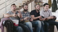 Male Friends Playing Video Games video
