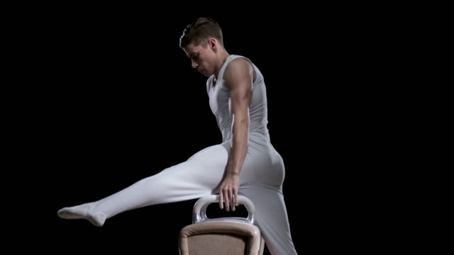 SLO MO Male gymnast mounting the pommel horse and performing his routine video