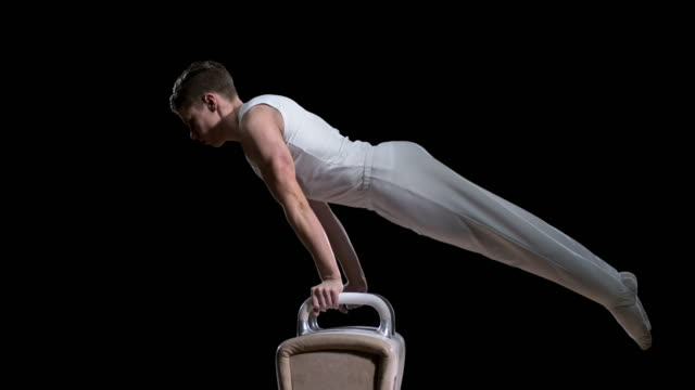 SLO MO Male gymnast performing a double leg circle on the pommel horse video