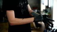 male hairdresser wears gloves in Barbershop video