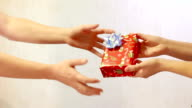 Male hand pass the red box gift box female hands video