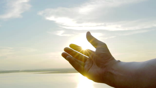 male hand play with sunset video
