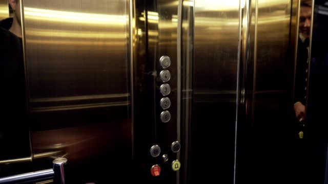 Male hand pushing the elevator button labeled with the number one. Front shot. video