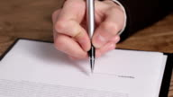 Male hand signing a document. video