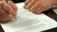 Male hand signing pages of contract, work with official document video