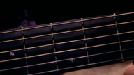 Male hand touching strings on fretboard. Music performance. FullHD macro video video