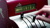 Male hand using an old vintage red cash register in liras video