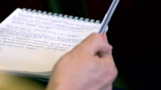 Male hand with pen and exercise book. Twirls a pen (close-up) video